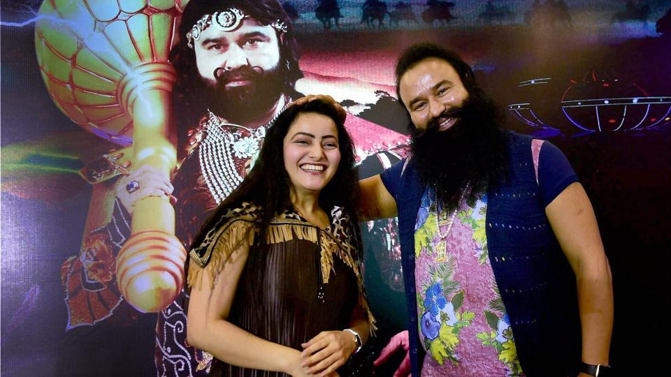 In this file photo, Honeypreet Insan is seen with Gurmeet Ram Rahim Singh at the promotion of the film ''MSG - The Warrior Lion Heart'' in Bengaluru.