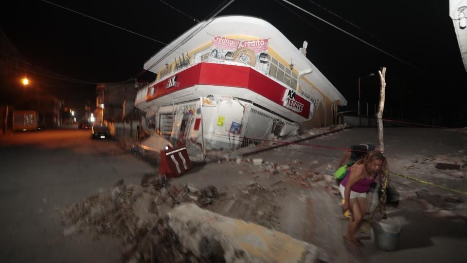 A woman walks past a collapsed building after a 7.1 earthquake, in Jojutla, Morelos state, Mexico on September. 19, 2017. The federal interior minister, Miguel Angel Osorio Chong, said authorities had reports of people possibly still being trapped in collapsed buildings. He said search efforts were slow because of the fragility of rubble. US President Donald Trump said on Twitter: 'God bless the people of Mexico City. We are with you and will be there for you.' (Eduardo Verdugo / AP)