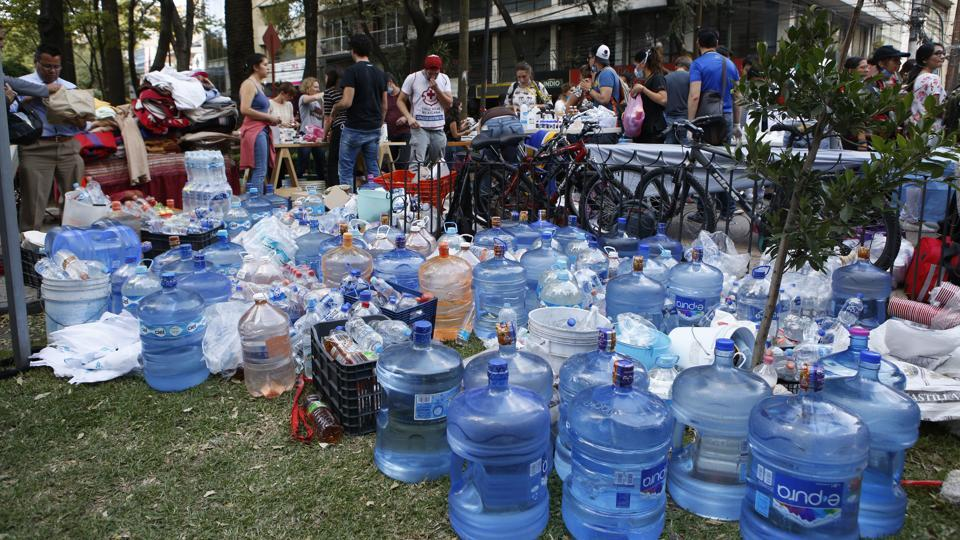 Volunteers gather water, medicine, and blankets donated by neighborhood residents in the Condesa neighborhood of Mexico City. Volunteers have urgently called for more supplies. 'We need batteries, torches, blankets, another megaphone, more tools, please bring us what we need,' one man said. (Rebecca Blackwell / AP)