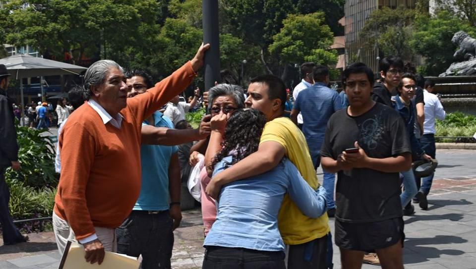 People react as a earthquake rattles Mexico City.