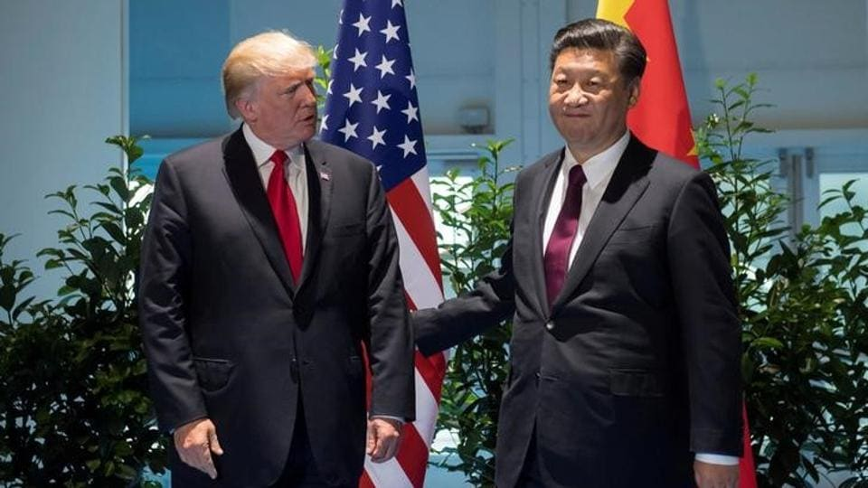 US President Donald Trump and Chinese President Xi Jinping (R) meet on the sidelines of the G20 Summit in Hamburg, Germany.
