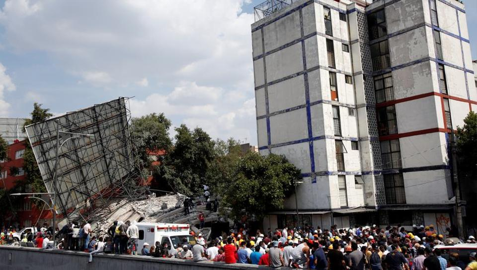 Soldiers, rescuers and people work at a collapsed building after an earthquake in Mexico City, Mexico.