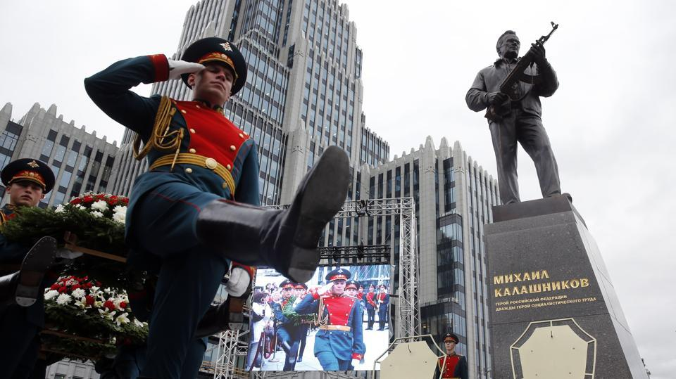 Perched atop a pedestal in a tiny square on Moscow's busy Garden Ring, Russia on Tuesday unveiled a statue of Mikhail Kalashnikov, inventor of the AK-47 assault rifle that became by some estimates the most lethal weapon ever made and the best known Russian brand abroad. 'I created a weapon for the defence of my fatherland,' runs a Kalashnikov quote hewn on the pedestal. At the unveiling ceremony, a Kremlin guard of honour stood to attention as Russia's national anthem played. (Maxim Zmeyev / AFP)