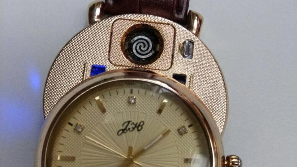 Flyers have been caught at Indian airports for carrying a lighter concealed in items such as a wrist watch (above) cream biscuit, perfume bottle, belt buckle, shoe ring and a wine bottle.