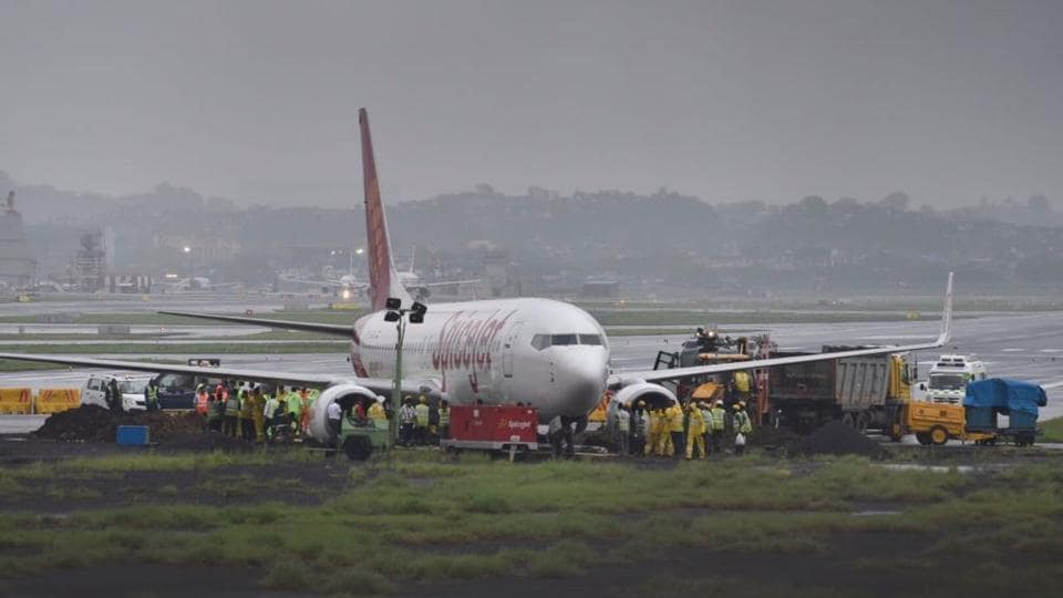 TheSpiceJet aircraft overshot the wet main runway while landing, and then got stuck in mud leading to suspension of flight operations on Tuesday.