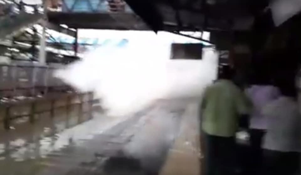 Train splashes water on the commuters in Nallasopara Station, Mumbai. (Facebook; Myron Anthony)