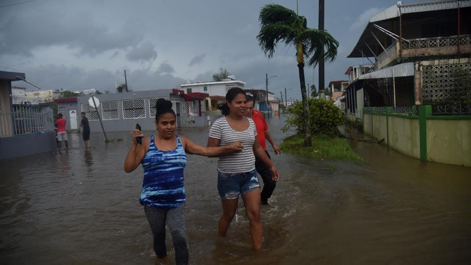 Inhabitants walk in flood water from the Puerto Nuevo river during the passage of Hurricane Maria, in San Juan. 'This might be a new, permanent part of our lives,' said Ramon Claudio Ortiz, 71, a retired lawyer. 'We're going to have to revisit our building codes.' Maria was the second-strongest hurricane ever recorded to make landfall in Puerto Rico, behind the 1928 San Felipe Segundo hurricane, which struck the island as a Category 5 storm and killed more than 300 people. (Hector Retamal / AFP)