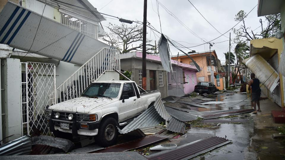 Residents of San Juan, Puerto Rico, dealt with damage to their homes on September 20, 2017, as Hurricane Maria battered the island. Slamming into Puerto Rico on Wednesday, Maria cut power on most of the US territory as terrified residents hunkered down in the face of the island's worst storm in living memory. After leaving a deadly trail of destruction on a string of smaller Caribbean islands, Maria made landfall on Puerto Rico's southeast coast around daybreak. (Hector Retamal / AFP)