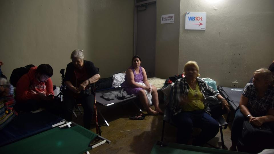 People take shelter at Roberto Clemente Coliseum in San Juan, as Hurricane Maria passes. Governor Rossello imposed a curfew from 6 p.m. to 6 a.m. daily until Saturday to allow rescue crews and officials to respond to the hurricane's aftermath. More than 11,000 people — and more than 580 pets — were in shelters, authorities said. (Hector Retamal / AFP)