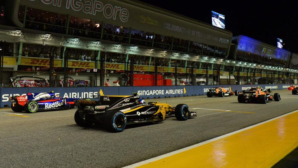 Drivers in their cars line up on the starting grid moments before the Formula One Singapore Grand Prix.