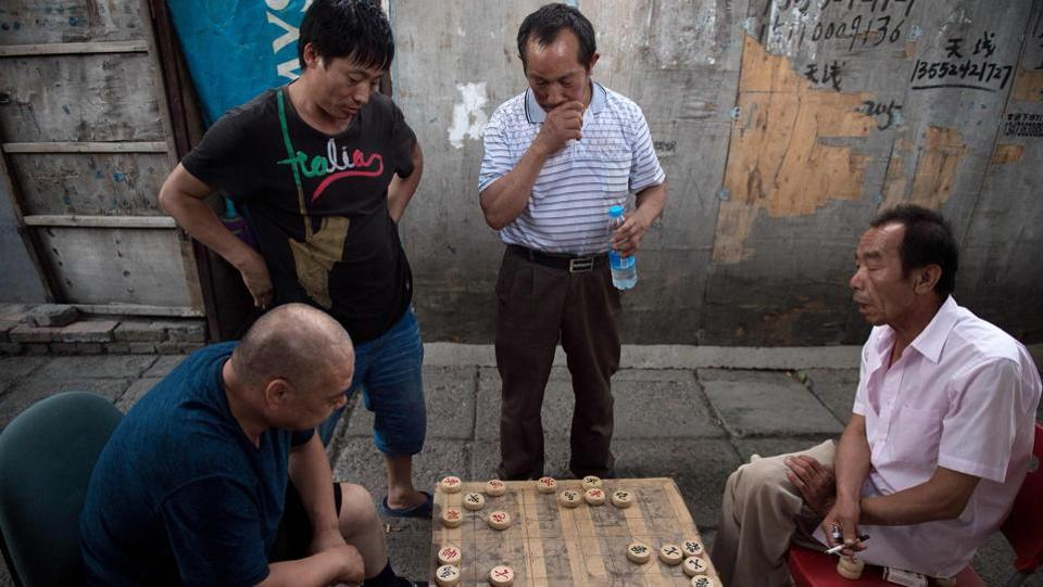 People play Chinese chess on a street in the migrant village on the outskirts of Beijing. China has hundreds of millions of migrants who have moved from the countryside to its towns and cities in recent decades to find work, their labour fuelling the country's economic boom. (Nicolas Asfouri / AFP)