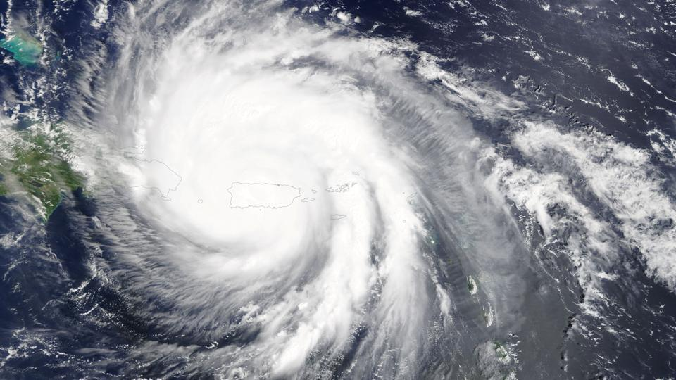 Hurricane Maria is pictured engulfing Puerto Rico in the Caribbean Sea in this September 20, 2017 NASA satellite photo. Reaching Puerto Rico ranked a Category 4 storm, with sustained winds of up to 155 miles per hour (250 km per hour), Maria ripped roofs from buildings and turned low-lying roadways into rushing debris-laden rivers cutting across the island. The island's 3.4 million people faced life-threatening winds for hours, the second time in two weeks in the wake of Hurricane Irma. (NASA / REUTERS)