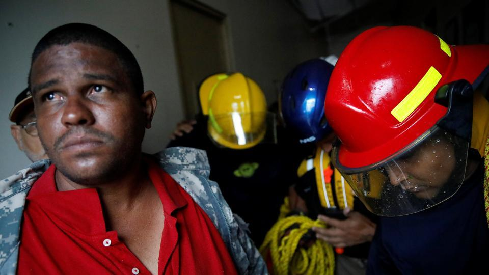 Rescue workers pray before walking out from the Emergency Operation Centre during Hurricane Maria in Guayama, Puerto Rico September 20, 2017. More than 11,000 people — and more than 580 pets — were in shelters, authorities said. Governor Ricardo Rossello urged people to have faith: 'We are stronger than any hurricane. Together, we will rebuild.' He asked President Donald Trump to declare the island a disaster zone, a step that would open the way to federal aid. (Carlos Garcia Rawlins / REUTERS)