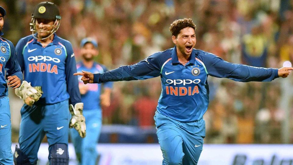 Kuldeep Yadav celebrates with MS Dhoni after taking a hat-trick in the second India vs Australia ODI at the Eden Gardens in Kolkata on Thursday.