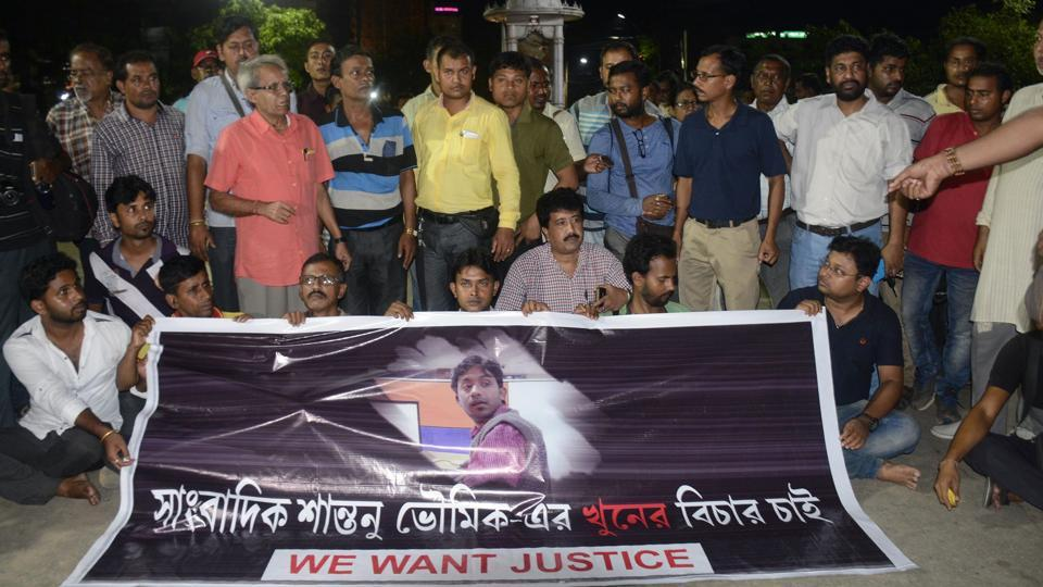 This September 20, 2017 photo shows journalists at a road blockade set up over the killing of journalist Shantanu Bhowmick in front of the chief minister's residence in Agartala.