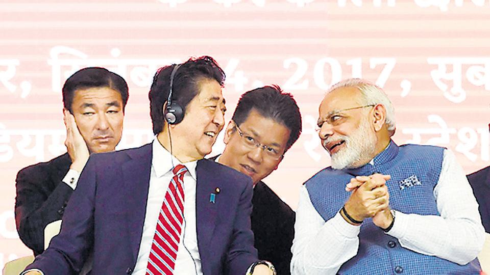 Prime Minister Narendra Modi and Japanese Prime Minister Shinzo Abe interact during a ground breaking ceremony for the Mumbai-Ahmedabad high speed rail project, Ahmedabad, 14