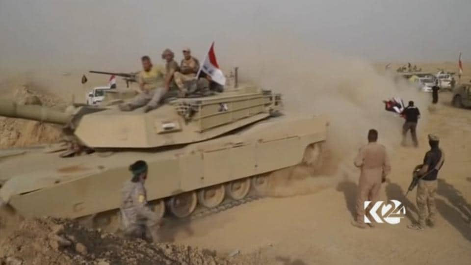 This image made from video provided by Kurdistan 24 shows an Iraqi tank moving into position as forces begun the operation to retake the town of Hawija, Iaq from the Islamic State group Thursday, Sept. 21, 2017.