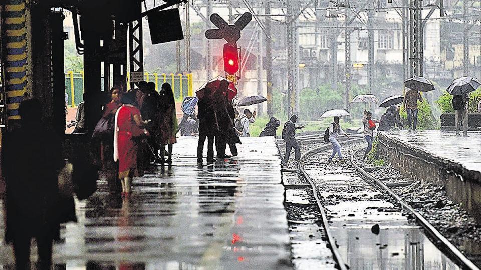 Commuters cross tracks in Mumbai on Wednesday.