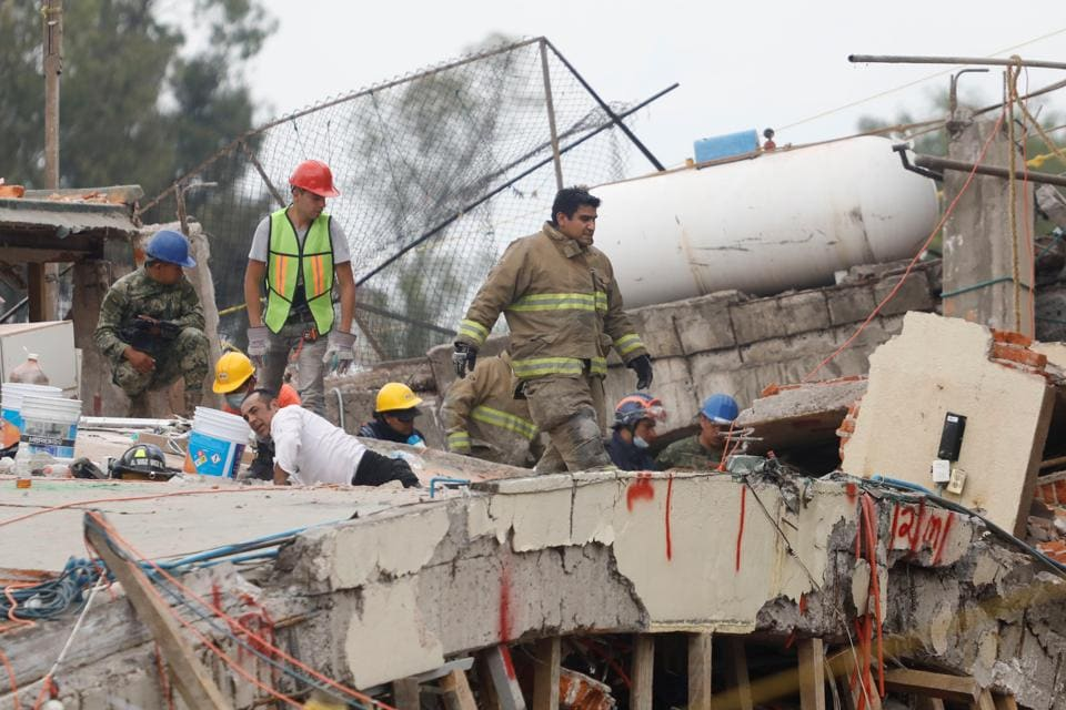 Rescue workers search through the rubble for students at Enrique Rebsamen school on September 20, 2017, after the earthquake in Mexico City.
