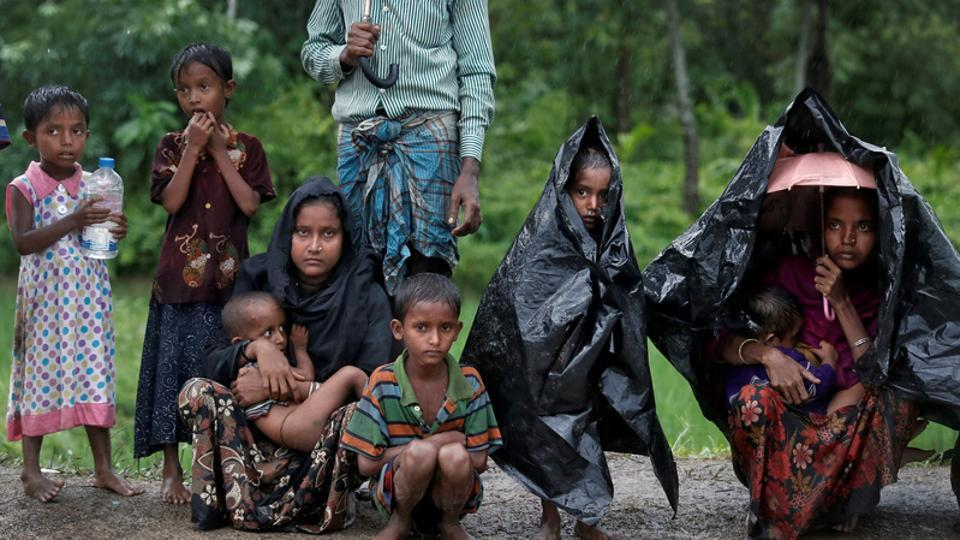 Rohingya refugees wait for aid in Cox's Bazar, Bangladesh, September 20, 2017.