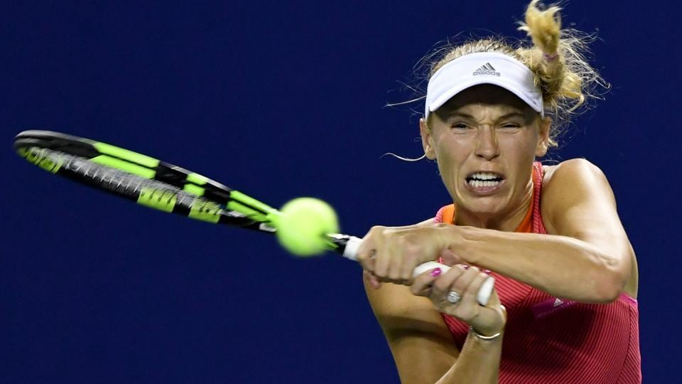 Caroline Wozniacki of Denmark hits a return against Shelby Rogers of the US during  the Pan Pacific Open tennis tournament.