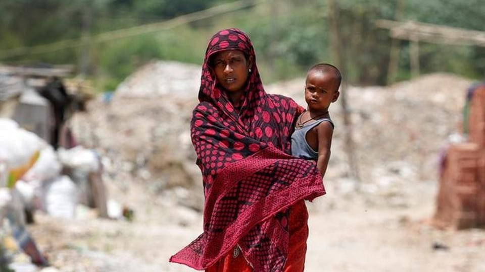 A woman from the Rohingya community walks through a camp in Delhi, India August 17, 2017. REUTERS/Cathal McNaughton/Files