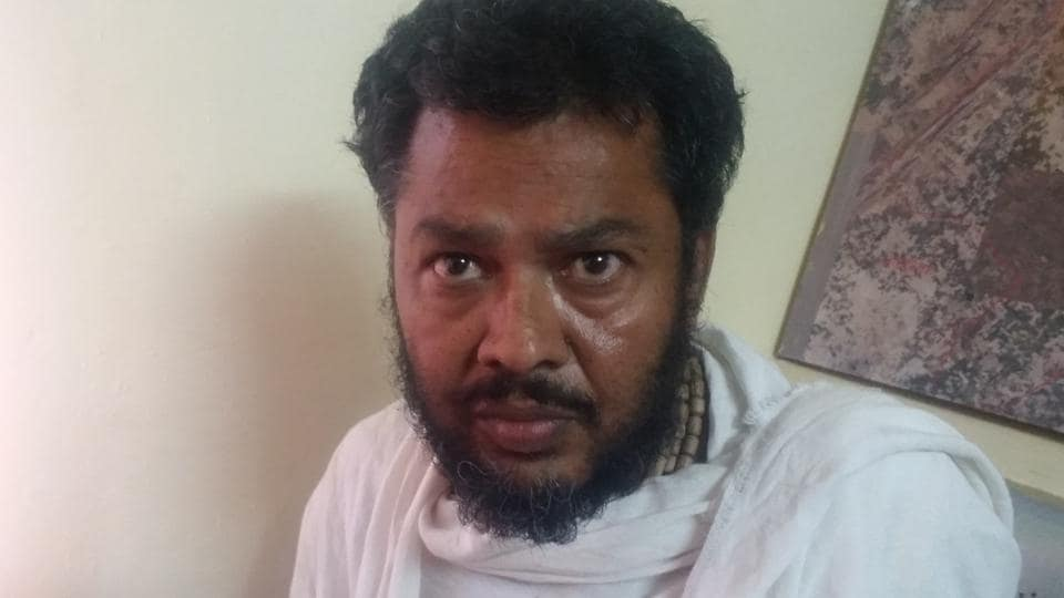Godman Mohan Govind Das in police custody at Mathura.