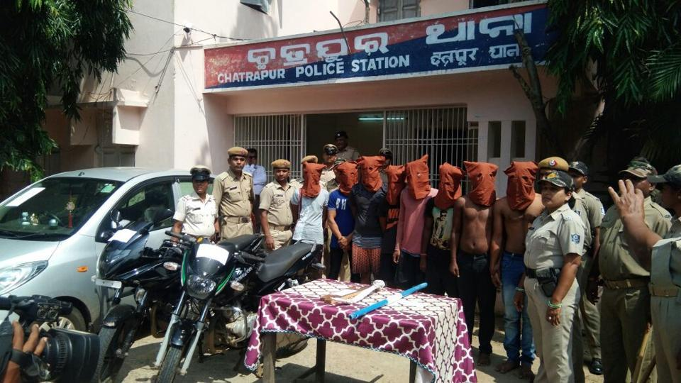 Odisha Police with the eight men arrested for the murder of a BJD councillor in Chhatrapur Notified Area Council in Ganjam district.