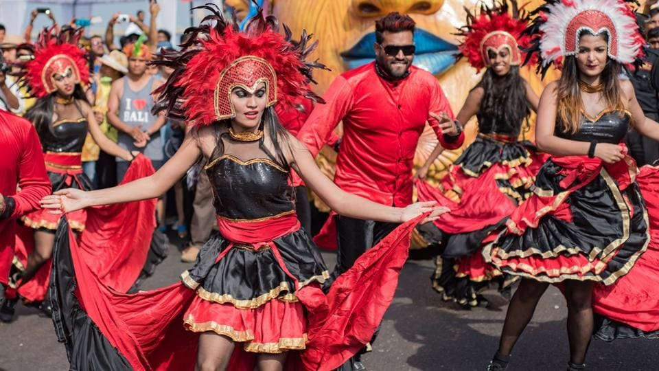 Dancers on the street during a festival in Goa.