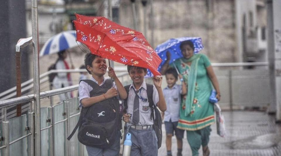 Delhiites woke up to an overcast sky on Friday morning and the mercury dipped as some parts of the city received rain.