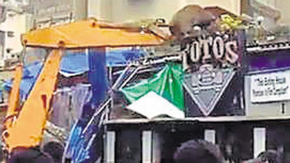 The BMC demolishes a portion of the bar in Mumbai on Thursday