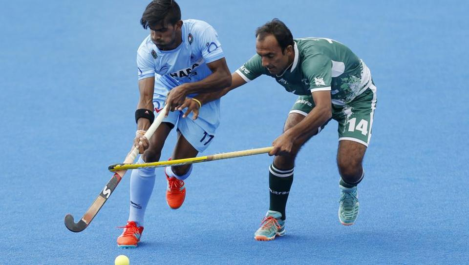 India's Mandeep Singh, left, and Pakistan's Muhammad Umar Bhutta in action during the FIH Men's World Hockey League match at Lee Valley Hockey Centre, London, on June 24, 2017. Pakistan have threatened to withdraw from the 2018 Hockey World Cup to be held in India in 2018.