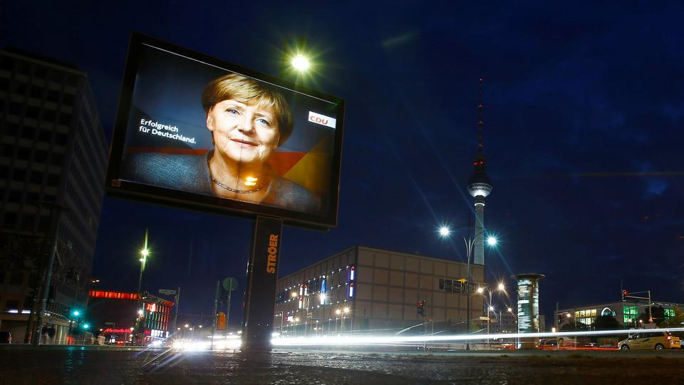 An election campaign poster for the upcoming general elections of the Christian Democratic Union party (CDU) with a headshot of German Chancellor Angela Merkel is displayed at Alexanderplatz square in Berlin, Germany, September 21, 2017