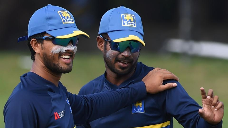 Sri Lankan cricket captain Dinesh Chandimal (L) and Upul Tharanga have signed a petition alongside other cricketers, asking Pramodaya Wickremesinghe to prove his fixing allegations.