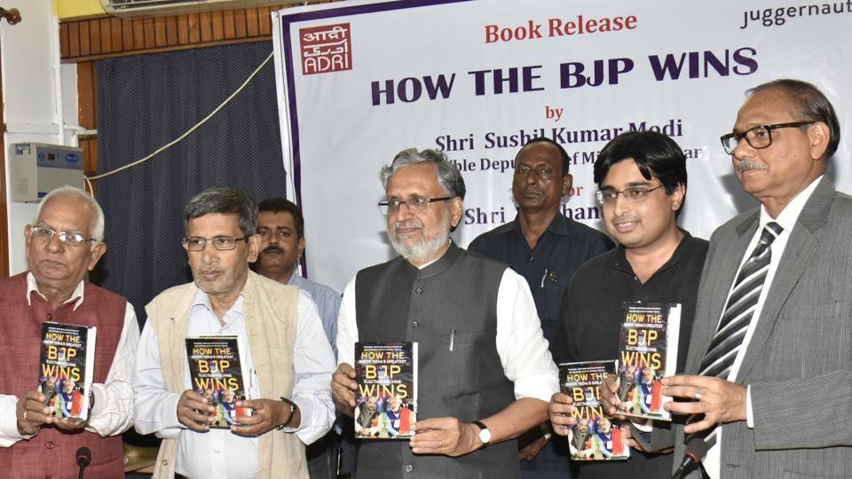 Bihar deputy CM Sushil Modi (centre) releasing Prashant Jha's book, 'How the BJP wins', in Patna on Friday.