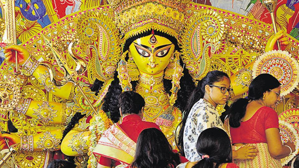 Bengali women play with vermilion during 'Sindur Khela' during the Durga Puja festival, in 2016.