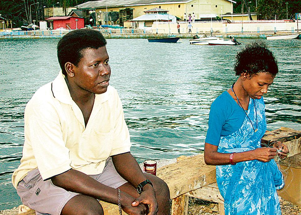 Siblings Mion (left) and Ichika, members of the Great Andamanese tribe, in Port Blair in 2005, on the first anniversary of the tsunami. 454 people died and 3,073 were listed as missing in the tsunami in 2004.