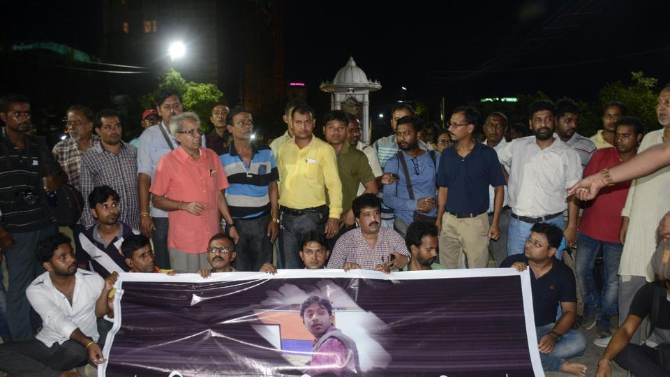 Journalists at a road blockade set up over the killing of journalist Shantanu Bhowmick in Agartala.