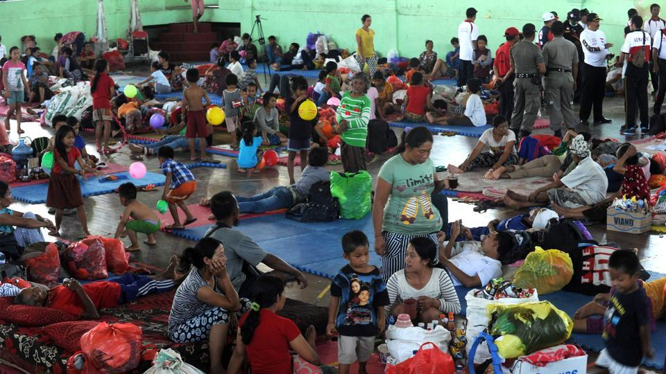 Villagers rest after being evacuated during the raised alert levels for the volcano on Mount Agung in Klungkung regency on the Indonesian resort island of Bali on September 22, 2017.