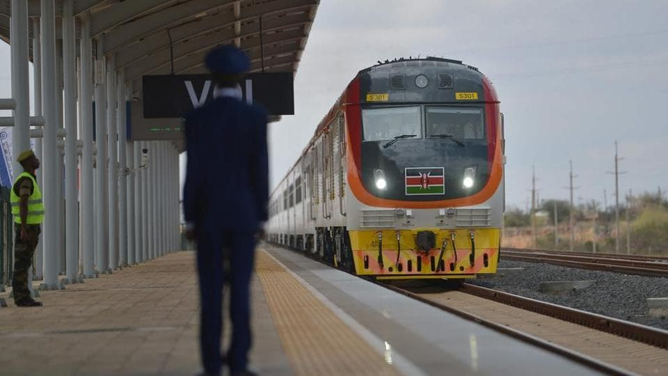 One of Kenya's newly acquired standard gauge rail locomotives, carrying Kenyan President pulls into Voi railway station on May 31, 2017, in Voi. Kenya's President Uhuru Kenyatta on Wednesday inaugurated a Chinese-built railway, the country's biggest infrastructure project since independence that is aimed at cementing its role as the gateway to East Africa.