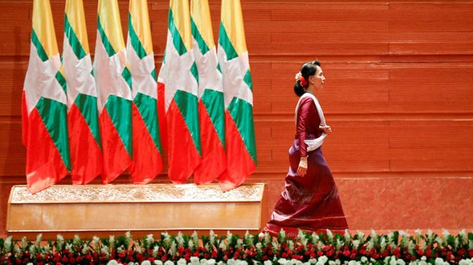 Myanmar State Counselor Aung San Suu Kyi walks off the stage after delivering a speech to the nation over Rakhine and Rohingya situation, in Naypyitaw, Myanmar September 19, 2017