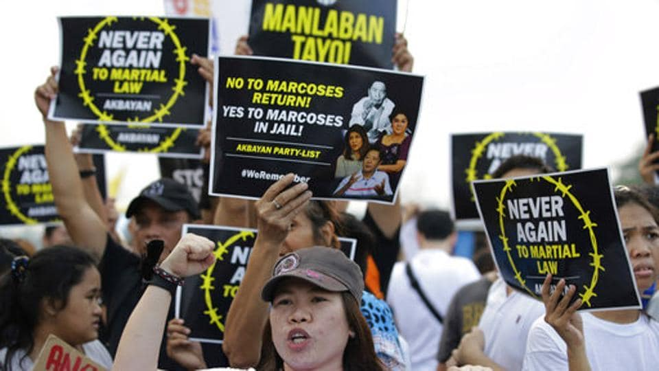 Protesters hold placards to observe the 45th anniversary of the imposition of martial law in Philippines. The Pew survey showed Duterte and his campaign against drugs are supported by most Filipinos, with 86% having a favourable view of Duterte and 78% supporting his handling of the problem. 'Despite international concerns levelled by various governments regarding Duterte's controversial clashes with drug cartels and potential human rights violations, the Filipino leader and his policies are widely popular,' Pew said. (Aaron Favila / AP)