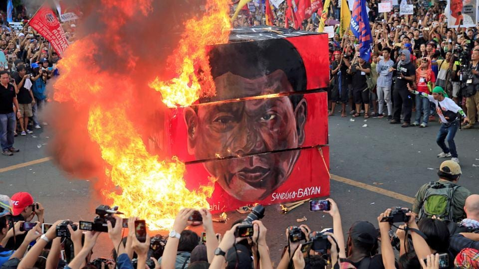 Thousands of protesters marked Thursday's anniversary of the 1972 declaration of martial law by late Philippine dictator Ferdinand Marcos as a National Day of Protest with an outcry against what they say are current president Rodrigo Duterte's authoritarian tendencies and his bloody crackdown on illegal drugs. (Romeo Ranoco / REUTERS)