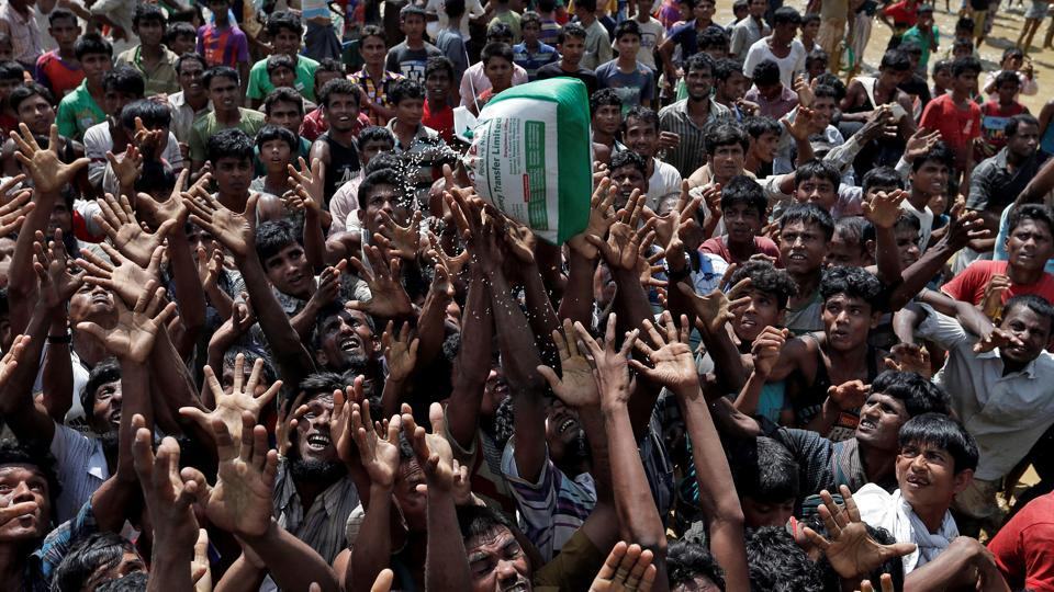 Rohingya refugees react as aid is distributed in Cox's Bazar, Bangladesh, September 21, 2017.