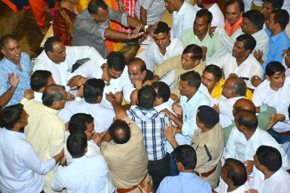 BJPand Congress councillors clash during the genreal body meeting of the Jaipur Municipal Corporation on Friday.