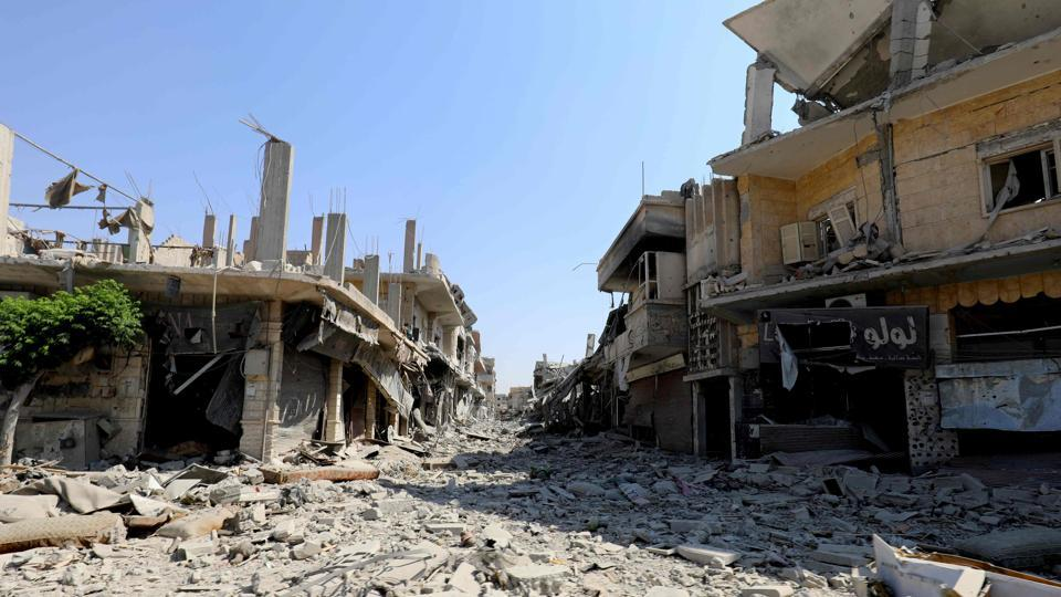 The remains of a locality in former Islamic State (IS) group stronghold of Raqa, as Syrian fighters backed by US special forces battle to clear the last remaining jihadists holed up in the city.