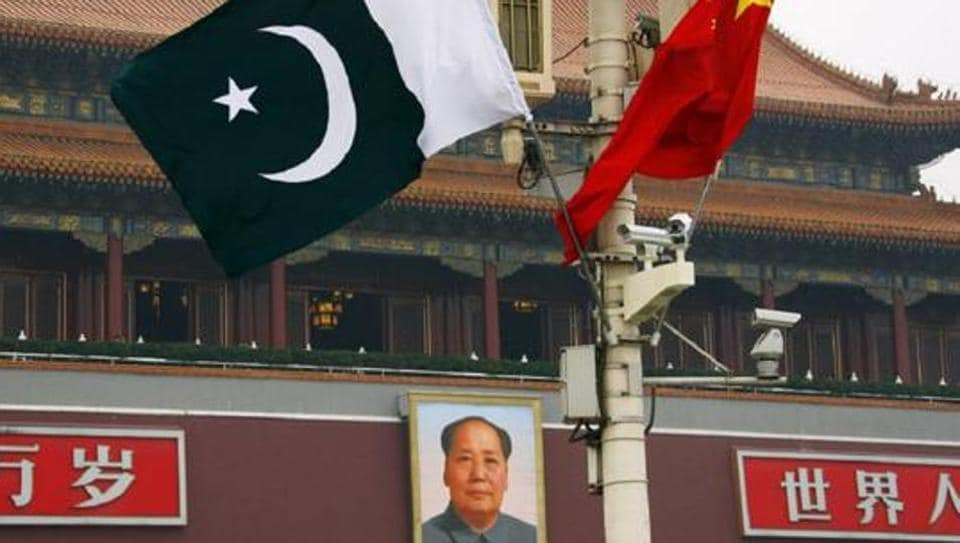 A Pakistan national flag flies alongside a Chinese national flag in front of the portrait of Chairman Mao Zedong in Beijing's Tiananmen Square.