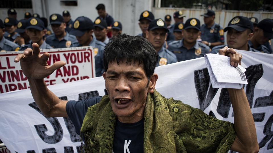 An activist shouts slogans against Duterte in front of the Armed Forces of the Philippines (AFP) headquarters in Manila. A separate rally was held at the Commission on Human Rights, which has been repeatedly denounced by Duterte for raising alarm over the campaign against drugs and its casualties. Duterte's allies in the House of Representatives initially voted to reduce the commission's annual budget to 1,000 pesos ($20) but reconsidered the decision amid outcries. (Noel Celis / AFP)