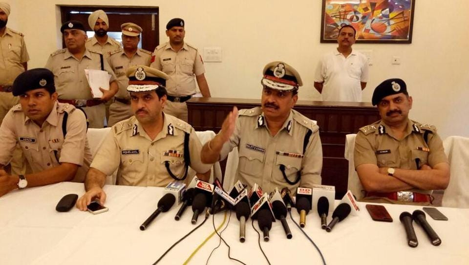Haryana DGP BS Sandhu addresses a press conference soon in Sirsa along with ADGP (law and order) Mohammad Akil, Hisar IG Amitabh Dhillon and Sirsa SP Ashwin Shenvi on Saturday.