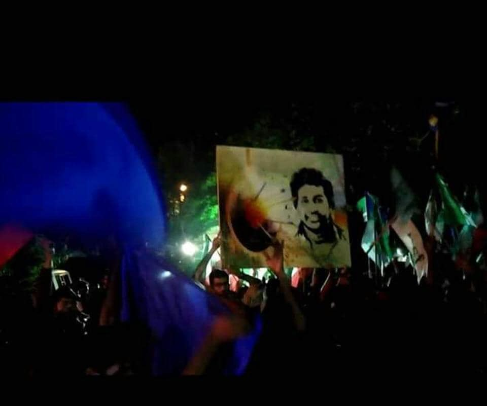 Supporters of Alliance for Social Justice celebrate victory of their candidates in the students' union elections of the University of Hyderabad holding aloft poster of Rohith Vemula